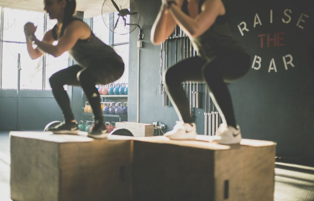 Women doing box jumps